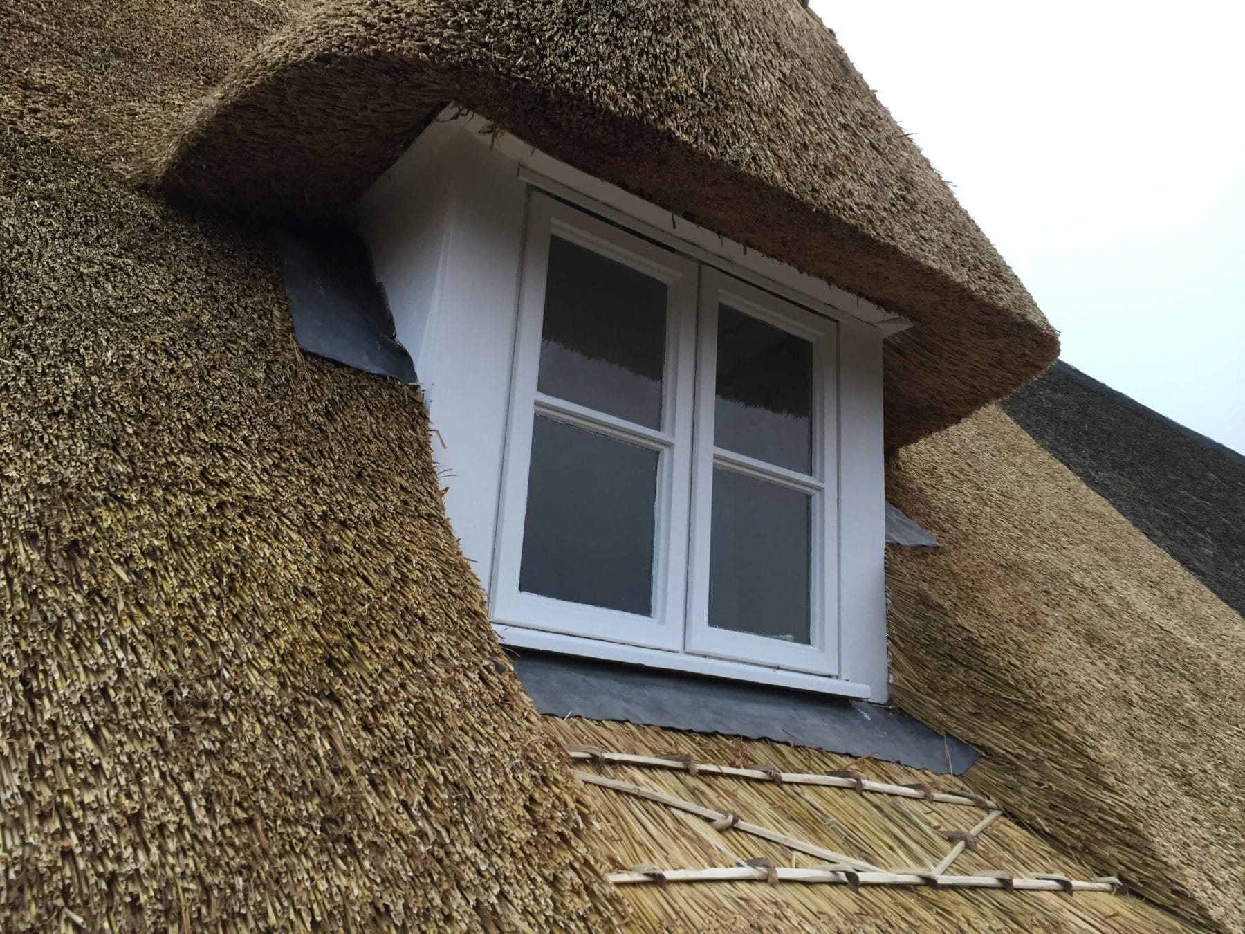 Thatched Roof with A Window View